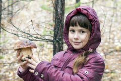 Young girl holding a white mushroom. Stock Photo
