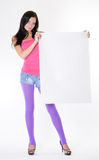 Young girl holding a white paper Stock Photo