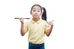 Young girl holding a wooden spoon. Stock Photo