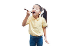 Young girl holding a wooden spoon. Little girl with spoon over white background Royalty Free Stock Photo