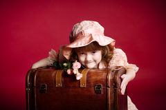 Young girl holding wooden treasure trunk Royalty Free Stock Photo