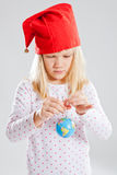 Young girl holding world in hands Stock Photo