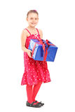 Young girl holding a wrapped present Royalty Free Stock Photo