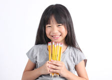 Young girl holding yellow pencils Stock Photos