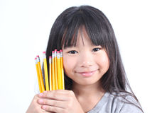 Young girl holding yellow pencils Stock Images