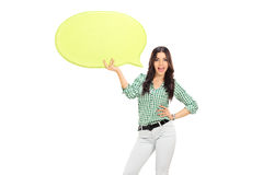 Young girl holding a yellow speech bubble Stock Photos