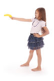 A young girl holds banana Royalty Free Stock Photos