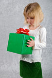 Young Girl Holds Christmas Present Royalty Free Stock Image