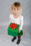 Young Girl Holds Christmas Present Stock Photo