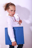 Young girl this holds a document folder in hand Stock Image