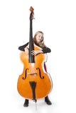 Young girl holds double bass in studio Stock Images