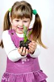 Young Girl Holds Green Plant Royalty Free Stock Photos