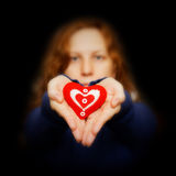 Young girl holds in hands red heart Stock Photography