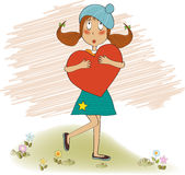 Young girl holds a heart Stock Images