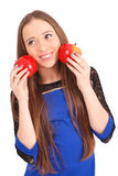 Young girl holds near the face apples Royalty Free Stock Images