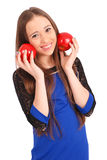 Young girl holds near the face apples Stock Photo