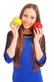 Young girl holds near the face apples Stock Image