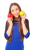 Young girl holds near the face apples Stock Photos