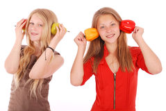 Young girl holds near the face apples and pears Stock Images