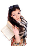 Young girl holds an opened book, got foxy look Royalty Free Stock Images