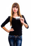 Young girl holds out business card. Stock Photography