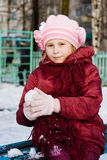 Young girl holds out his hand in a snowball Royalty Free Stock Photos
