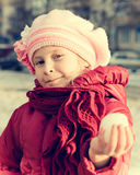 Young girl holds out his hand in a snowball Stock Photo