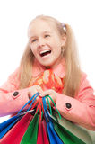 Young girl holds purchases Royalty Free Stock Photo