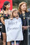 A young girl holds a sign that reads Protect Dreamers. BEVERLY HILLS, CALIFORNIA - MARCH 12, 2018: A young child holds a sign that reads, `Protect Dreamers` at Royalty Free Stock Photography