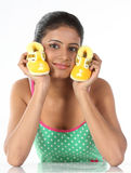 Young girl holds small baby booties in her palm Stock Image