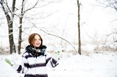 Young girl holds snowballs in winter landscape Royalty Free Stock Images