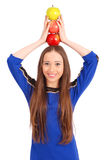 Young girl holds an three apples Royalty Free Stock Photo