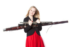Young girl holds woodwind instruments in studio Royalty Free Stock Images