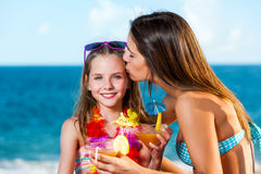 Young girl on holiday with mother. Stock Images
