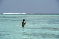 Young girl in holiday at Paradise Island, Maldives. March 2012 Royalty Free Stock Images