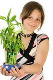Young girl with home plant bam. Boo. Focus point on face. Isolate on white Royalty Free Stock Photos
