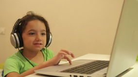 Young girl at home using a laptop stock video footage