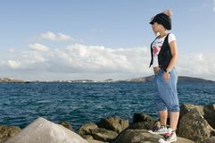 Young girl homeless near the sea stock images