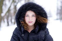 Young girl in the hood with fur Stock Photography