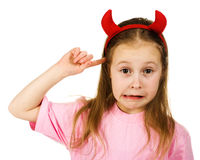 Young girl with horns imp Stock Photography