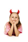 Young girl with horns imp Stock Images