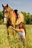 Young girl and horse Stock Photo