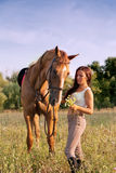 Young girl and horse Stock Image