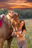 Young girl and horse Royalty Free Stock Photos