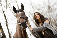 Young girl with a horse Stock Photography