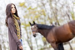 Young girl with a horse Royalty Free Stock Photo