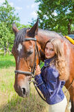 Young girl with a horse. Royalty Free Stock Photography