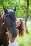 Young girl with a horse. Stock Photo