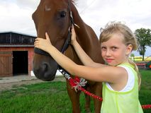 Young girl and horse. A young girl staying with a horse. Close up Stock Photo
