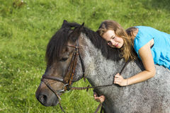 Young girl with horse Royalty Free Stock Photos